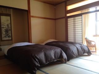 福島・南相馬市の旅館 抱月荘 和洋室写真・畳・ベッド